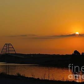 Sun setting by the Bridge by Bobbie Moller