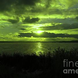Sundown on a Winter lake by Jeff Swan