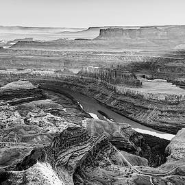 Sunlight Over Dead Horse Point State Park - Black And White by Gregory Ballos