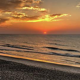Sunrise in Buxton North Carolina  by Geraldine Scull
