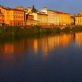 Sunrise reflection on Arno River by Warwick Lowe