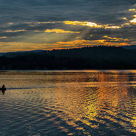 Sunset Kayaking  by Betty Pauwels