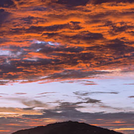 Sunset light on cloud and shade of hill by Kumud Parajuli