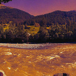 Sunset Over The Austrian Alpine River by Bumsable