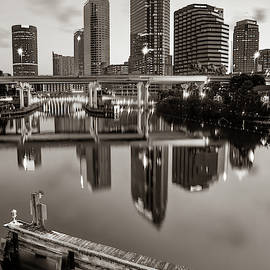 Tampa Skyline At Dawn Over The Riverwalk In Sepia by Gregory Ballos