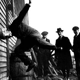Testing Football Helmets - Circa 1913 by Doc Braham