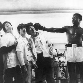 The Beatles And Muhammad Ali In 1964 by Keystone-france