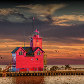 The Big Red Lighthouse at Sunset on Lake Michigan by Ottawa Beac by Randall Nyhof
