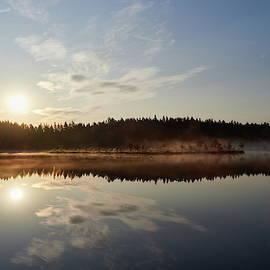 The lake the mist and the morning sun in Seitseminen by Jouko Lehto