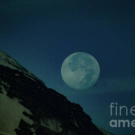 The moon on the slopes of Mount Rainer  by Jeff Swan
