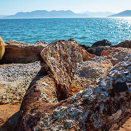 The Rusty Anchor At Aegina Port by Iordanis Pallikaras