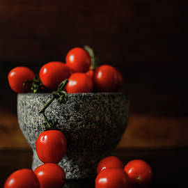 Tomatoes on the Branch in Stone Bowl by Cassi Moghan