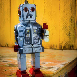 Toy Robot On Old Table by Garry Gay