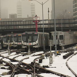Trains On Snow Covered Tracks by Alfred Ng