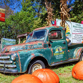 Truck at the Sunrise Grocery by Debra and Dave Vanderlaan