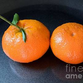 Two clementines by Inessa Williams