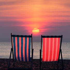 Two Deckchairs at Sunset, Beer Beach by Maggie Mccall