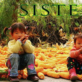 Two little sisters at corn harvest by Leslie Struxness