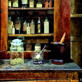 Two Mortar And Pestles And Glass Jar by Susan Savad