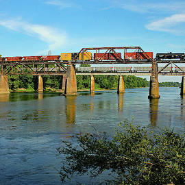 Two Trains over a River by Joseph C Hinson