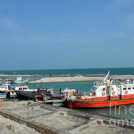 Under construction harbor with ships at Kurikadduwan Jaffna Peninsula Sri Lanka by Imran Ahmed