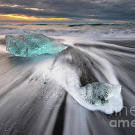Icebergs on a Black Sand Beach at Sunrise by Tom Schwabel