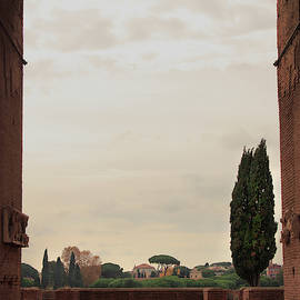 View Through Archway Of Domitians Palace On Palatine Hill At Sunset by Angela Rath