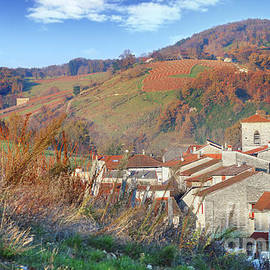 Village in autumn season by Gregory DUBUS
