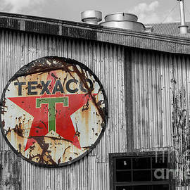 Vintage texaco sign on old building by Patricia Hofmeester