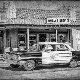 Wally's Service Station by George Moore
