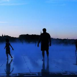 Water Spray Play At Sunset by Joan Stratton