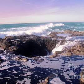 Waves rushing in at Thor's Well by Jeff Swan