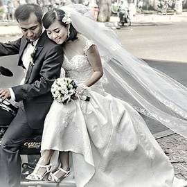 Wedding Couple On A Motorcycle by Toni Abdnour