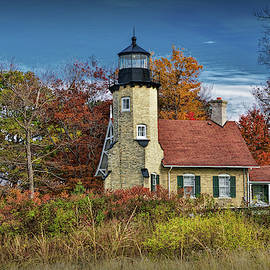 White River Light in Autumn by Whitehall Michigan by Randall Nyhof