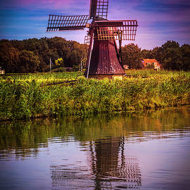 Windmill In The Early Morning by Debra and Dave Vanderlaan