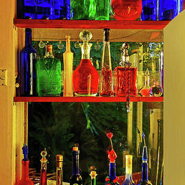 Window of Colorful Bottles by Kaye Menner