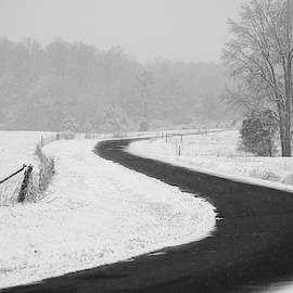 Windy Road Passing Through the Snowy Fields by Stamp City