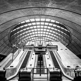 Canary wharf underground station escalators, London, England by Neale And Judith Clark
