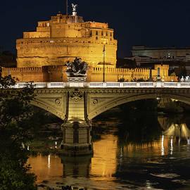Castle and Bridge in Rome at Night by Artur Bogacki