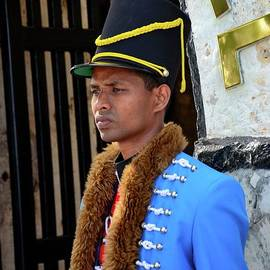 Ceremonial guard in colonial blue red uniform stands guard at Fort Hammenhiel Hotel Jaffna Sri Lanka by Imran Ahmed