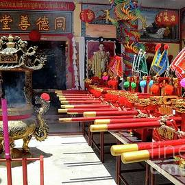 Chinese temple door flags joss urn and King portrait Pattani Thailand by Imran Ahmed
