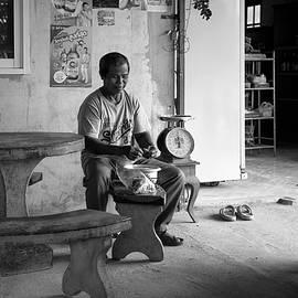 Shopkeeper Cooking Breakfast  by Lee Craker