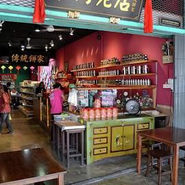 Customers browse Chinese food shop Jalan Padungan Kuching Sarawak Malaysia by Imran Ahmed