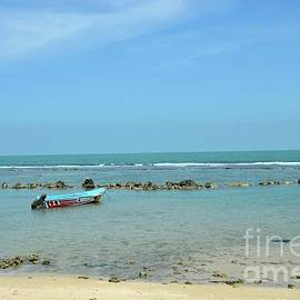 Fishing motor boat parked in shallow water beach Jaffna Peninsula Sri Lanka by Imran Ahmed
