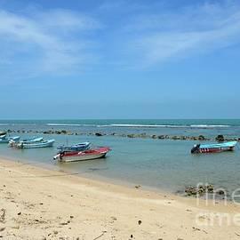 Fishing motor boats parked in shallow water beach Jaffna Peninsula Sri Lanka by Imran Ahmed