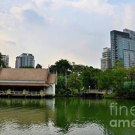 Lake and house with skyline at Lumphini Park Bangkok Thailand by Imran Ahmed