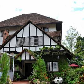 Main entrance to colonial era Tudor style bungalow cottage now a hotel Cameron Highlands Malaysia by Imran Ahmed