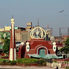 Modern mosque in city center traffic roundabout Multan Pakistan by Imran Ahmed