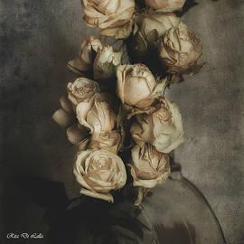 Bottled roses by Rita Di Lalla
