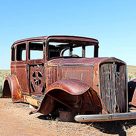 Route 66 Monument and 1932 Studebaker In The Painted Desert by Matt Richardson